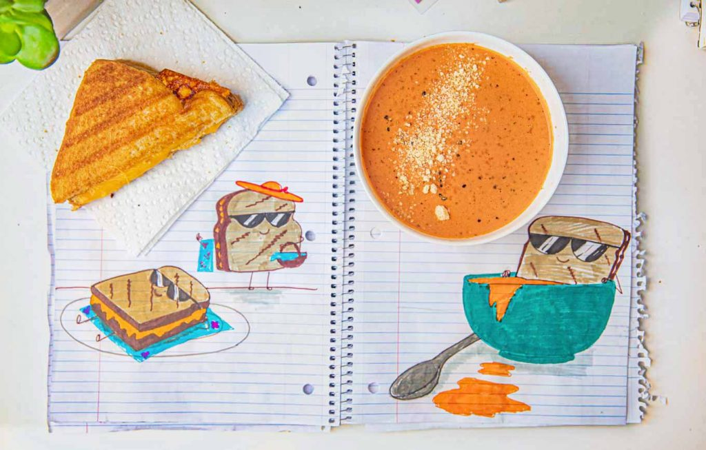 Microwave Creamy Tomato Soup from above with half a grilled cheese sandwich