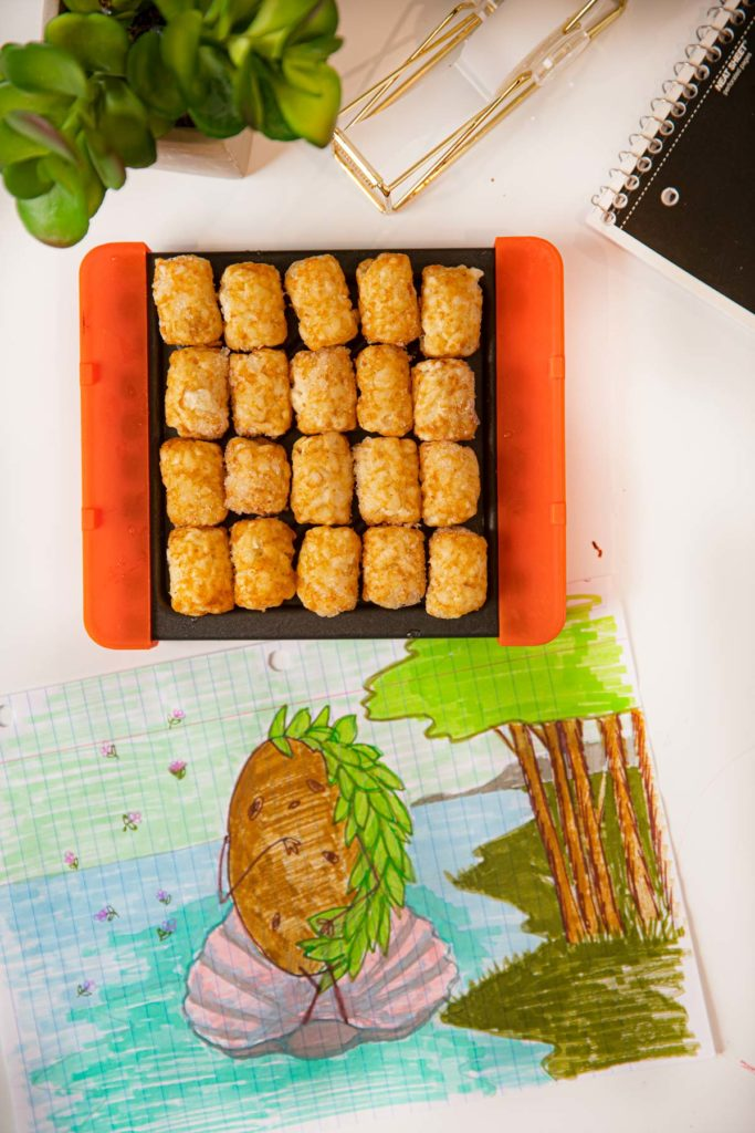 Crispy Tater Tots in microwave grill pan on drawing