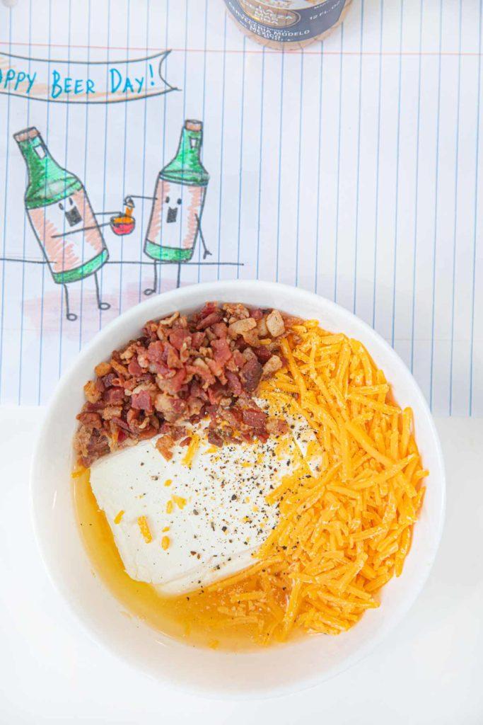 Microwave Beer Cheese Dip ingredients in cereal bowl