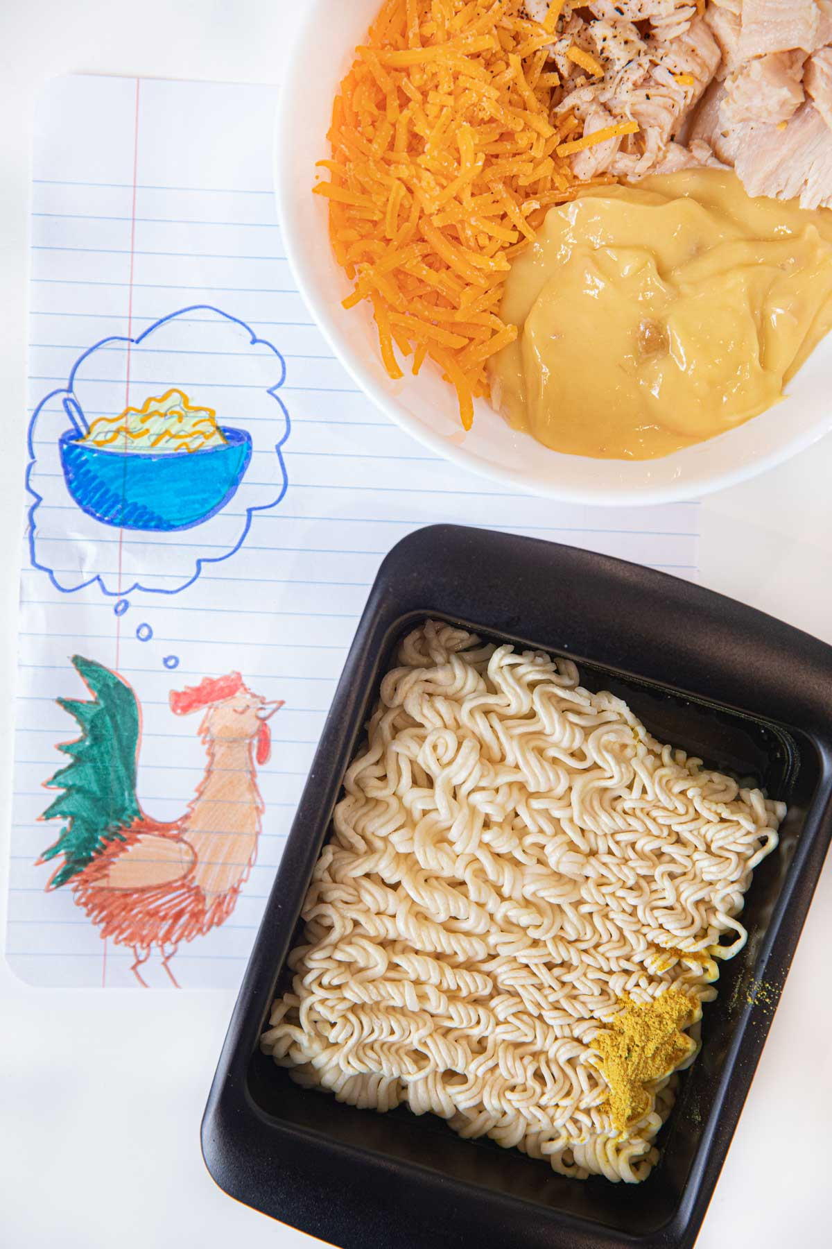 Creamy Cheesy Chicken Ramen ingredients in bowl and ramen cooker